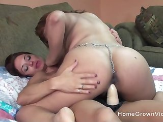 Busty amateur lesbian is ready to have her tight pussy stuffed by her girlfriends big dildo!
