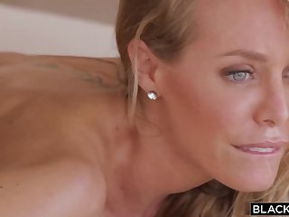 Beautiful platinum-blonde cougar, Nicole Aniston is getting a dark-hued male's gigantic spear, in the bedroom