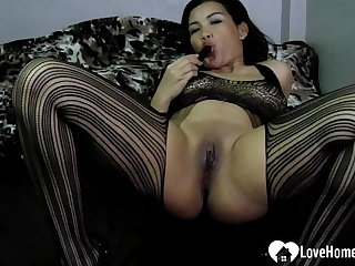 Beautiful Asian mom fingers her love tunnel