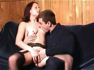 Sex starved diva in stockings enjoys a doggystyle sex action on the couch