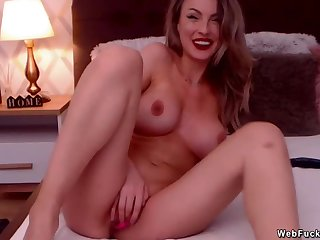 Buxom camgirl masturbates with sextoys