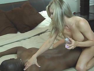 White girl massaging a black stud